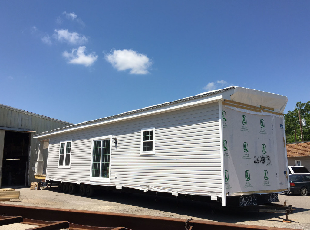 Narrow lot modular homes down east realty custom homes for Narrow lot