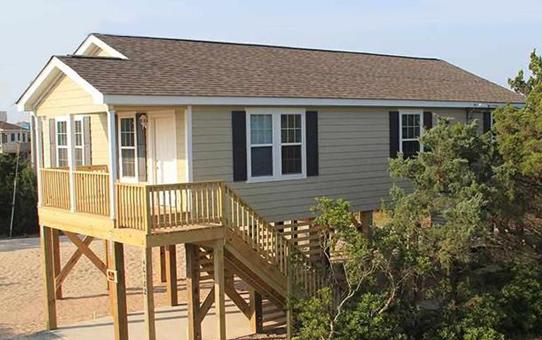 Narrow lot modular on sale down east realty custom homes for Narrow modular homes
