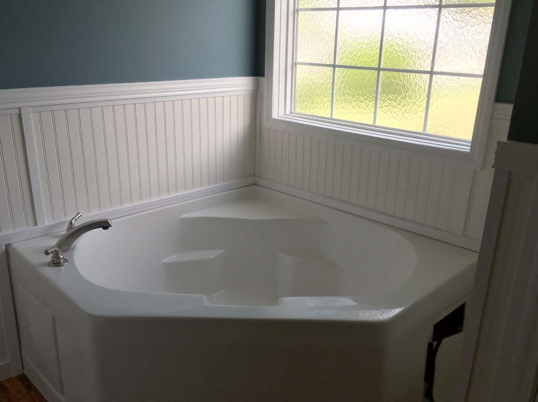 Master bathtub down east realty custom homes for Tub master