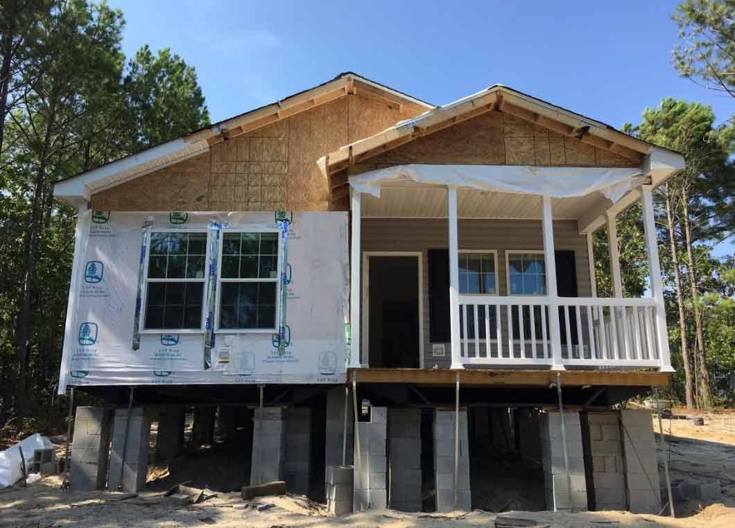 Narrow lot modular on sale down east realty custom homes for Narrow lot