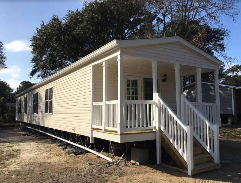 Front porch single wide down east realty custom homes for Single wide mobile homes with front porches