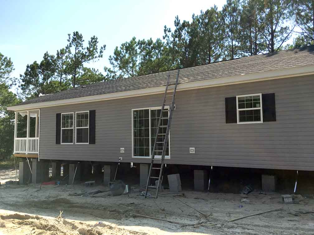 Narrow lot modular new finishes down east realty for Narrow modular homes